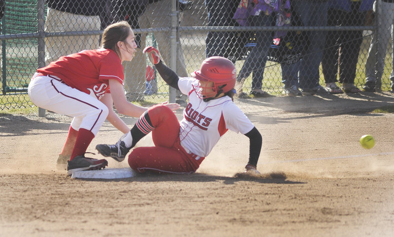 South Portland's Lorinne Bateman slides into third ahead of the throw to Scarborough's Maggie Murphy.
