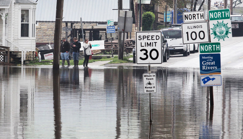Water covers the intersection of routes 100 and 3 in Grafton, Ill. on Tuesday. Floodwaters were rising to record levels along the Illinois River in central Illinois.