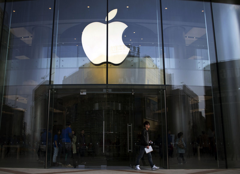 Apple is offering to pay $3.05 per share in dividends as the company prepares to pay investors for the first time. The stock price still slid 0.7 percent Tuesday.