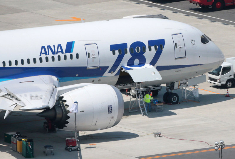 Modified batteries are put in a grounded All Nippon Airways Boeing 787 jet this week in Okayama, Japan.