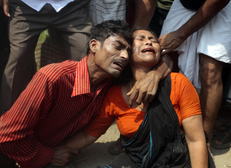 Relatives mourn a victim at the site where an eight-story garment factory collapsed in Savar, Bangladesh, on Wednesday, killing at least 87 and leaving many more trapped in the rubble.
