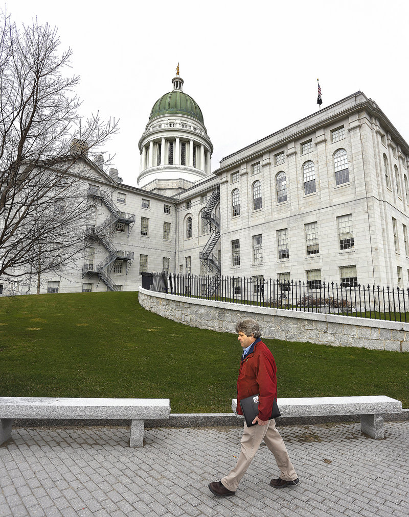 David Trahan, executive director of the Sportsman's Alliance of Maine, walks up to the State House in Augusta for an afternoon of lobbying on gun legislation issues last Wednesday.