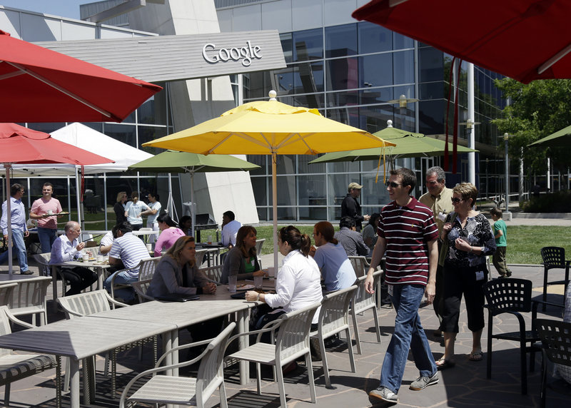 Employees and visitors congregate Thursday in a courtyard at Google headquarters in Mountain View, Calif. The company is under pressure in Europe to reduce antitrust concerns by changing the way it displays Internet search results.