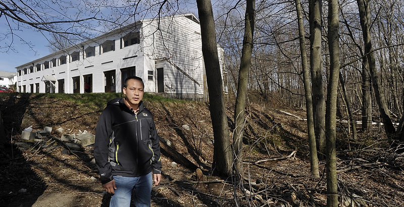 Tim Ly of MaineLy Property Management stands on the property owned by South Portland that he wants to buy.