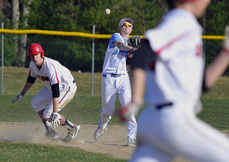 Brett Goodnow of Westbrook throws to first in an attempt to complete a double play Thursday after forcing Ben Greenberg of Scarborough at second base. Scarborough avoided the double play and went on to a 7-0 victory at Olmsted Field in Westbrook.