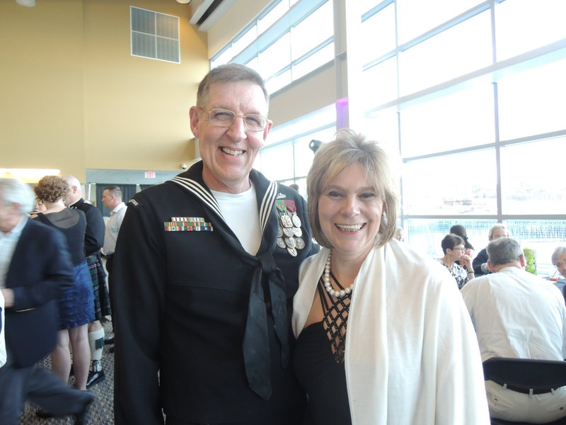 Steven and Karen Michaud at the Goodwill event. Steven, who recently retired from the Navy, attended in uniform, while Karen modeled a $21 Goodwill ensemble in the Goodwill finds fashion show.