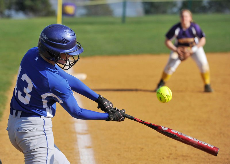 Katelyn Wilson of Kennebunk hits a grounder to Cheverus third baseman Katie Roy, waiting for the ball right from the crack of the bat, during Cheverus' 6-1 victory Friday.
