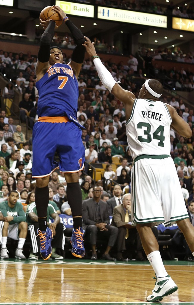 Carmelo Anthony of the Knicks shoots over Paul Pierce during New York's 90-76 victory Friday night in Boston. The Knicks can complete a sweep of the first-round series on Sunday.