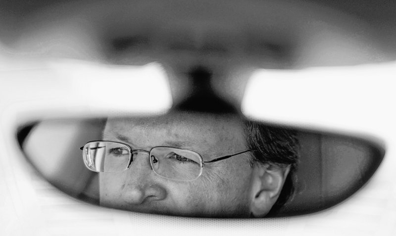 Mike Quincy, automotive specialist at Consumer Reports, is reflected in a rear-view mirror while giving a tour.