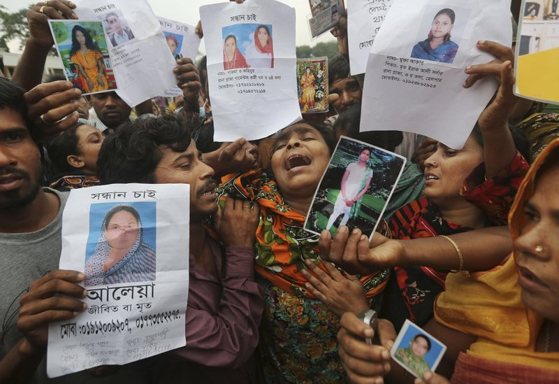 Relatives of Bangladeshi garment worker Mohammed Abdullah openly grieve.