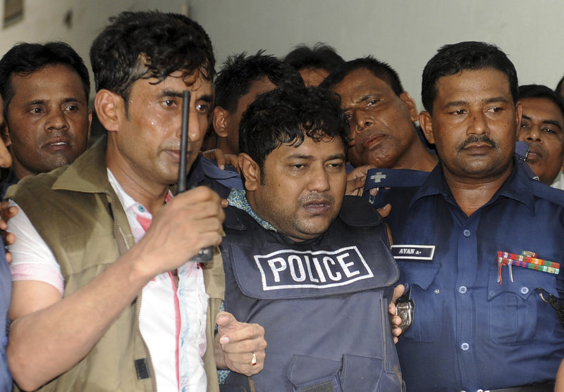 Mohammed Sohel Rana, center, owner of the collapsed building is brought to a court in Dhaka, Bangladesh, Monday.