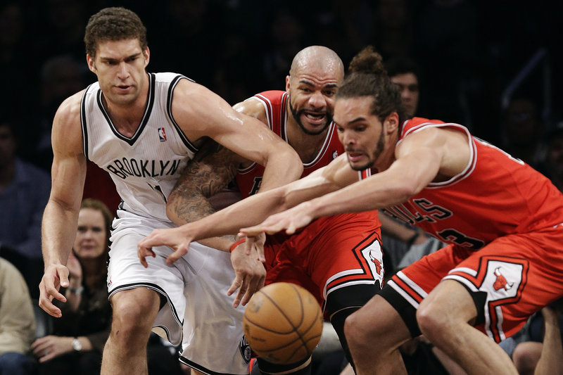 Brooklyn center Brook Lopez, left, Chicago forward Carlos Boozer and center Joakim Noah lunge at a loose ball during Monday's game in New York.
