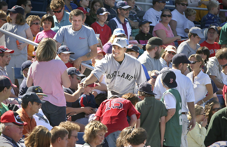 Tim Greenway/Staff Photographer: Sea Dogs catcher Juan Apodaca shakes hands with fans before the annual Field of Dreams game at Hadlock Field. The Sea Dogs wore uniforms from the Portland Eskimos of the 1920s, and walked through the stands to thank fans for their support. Baseball