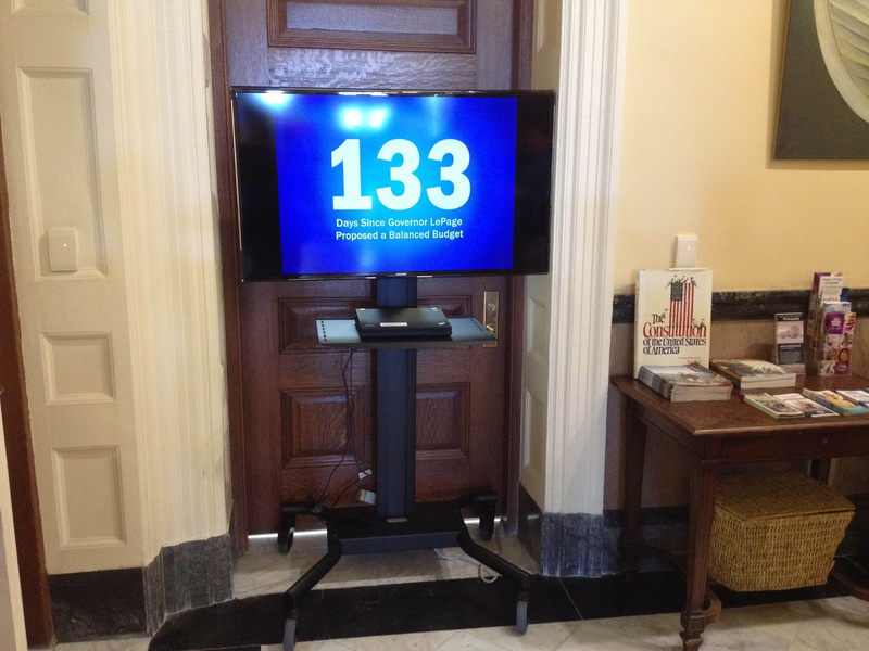 Gov. Paul LePage installed a flat-screen television outside his office in the Hall of Flags. He says he'll move out of the State House because he Legislature, which controls that area, told him to remove it or at least follow proper procedure and request permission to have it.