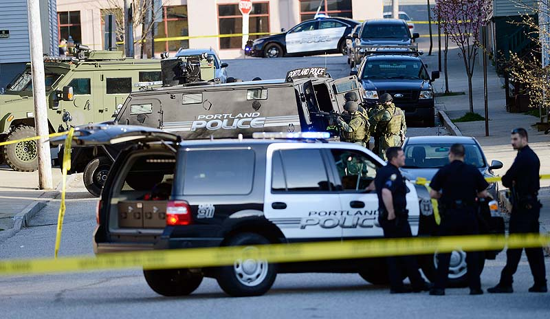 Portland police and SWAT team members respond to a standoff at 41 Alder St. in Portland on Monday.