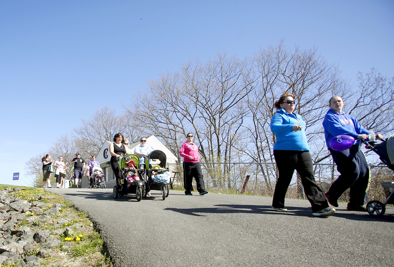 Walkers head to Baxter Boulevard at the start of the March of Dimes March for Babies fundraiser at Cheverus High School in Portland on Sunday.