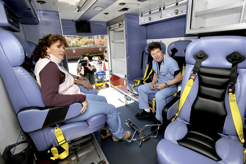 Registered Nurse Laura Barra and respiratory therapist John Fischer inspect the interior of a new pediatric ambulance at Maine Medical Center on Tuesday.