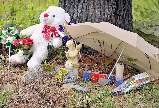 Items of love and remembrance lie at the base of a memorial to Nichol Cable, who was missing for about a week before her body was found in a wooded area in Old Town.