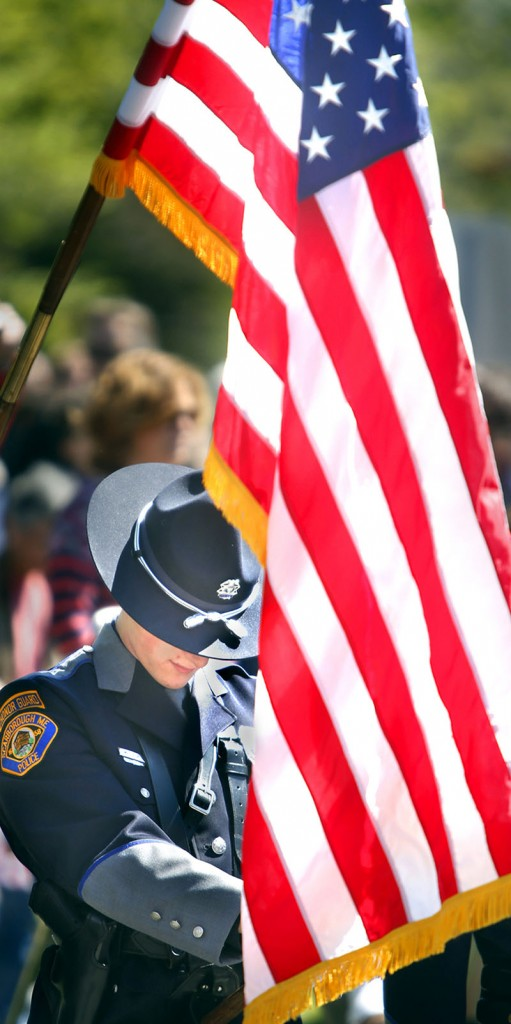 Michael Thurlow, a member of the Scarborough Police Department Honor Guard, bows his head during a prayer for the veterans and current service members during the Scarborough Memorial Day ceremony at the Maine Veterans' Home Monday morning.