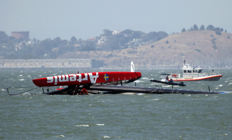 The overturned Artemis Racing AC72 catamaran, an America's Cup entry from Sweden, is towed past Treasure Island after the boat capsized during training in San Francisco Bay on Thursday.