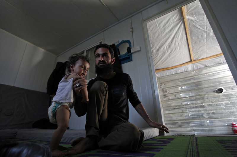 Former Free Syrian Army fighter Bilal al-Ammari, 28, holds his infant daughter at the Zaatari refugee camp near the Syrian border in Mafraq, Jordan, last month. More U.S. aid is going to refugees.
