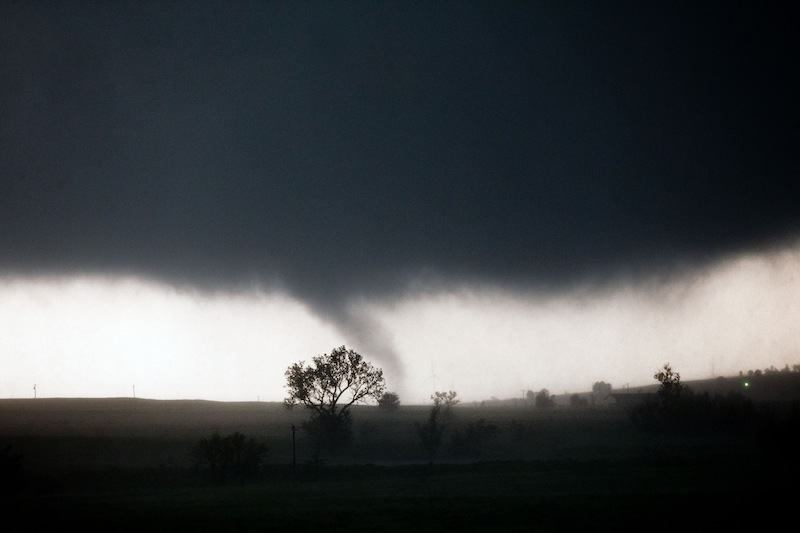A tornado touches down near El Reno, Okla., Friday, May 31, 2013, causing damage to structures and injuring travelers on Interstate 40. I-40 has been closed after severe weather rolled through the area. (AP Photo/Omaha World-Herald, Chris Machian)