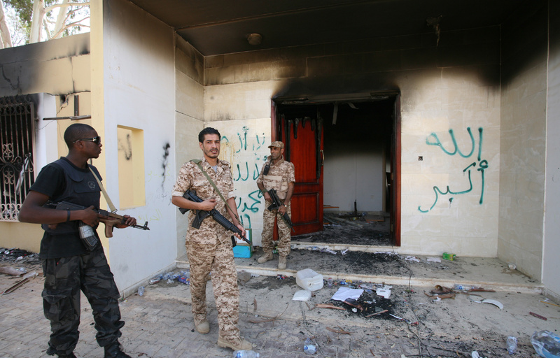 Libyan military guards check one of the U.S. Consulate's burned-out buildings after a deadly attack there in Benghazi, Libya.