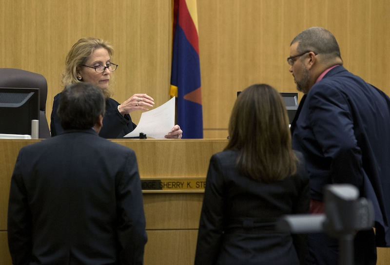 Judge Sherry Stephens looks at a question from the jury with prosecutor Juan Martinez, left, and defense attorneys Jennifer Wilmott and Kirk Nurmi, right, on Wednesday, May 22, 2013 during the penalty phase of the Jodi Arias murder trial at Maricopa County Superior Court in Phoenix . Arias was convicted of first-degree murder in the stabbing and shooting to death of Travis Alexander. (AP Photo/The Arizona Republic, Rob Schumacher, Pool)