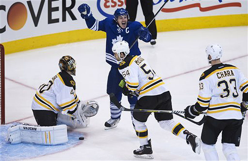 Toronto's Dion Phaneuf reacts after getting the puck past Boston Bruins goalie Tuuka Rask in the third period Sunday in Toronto.