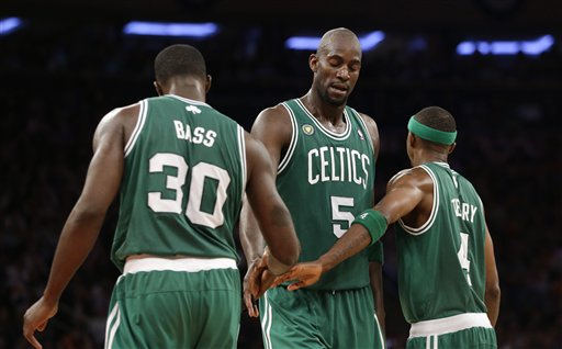 Boston Celtics forward Brandon Bass, Celtics center Kevin Garnett (5) and Celtics guard Jason Terry (4) react to a play in Game 5 of the first-round playoff series against the Knicks. The Celtics went on to idefeat the Knicks 92-86.