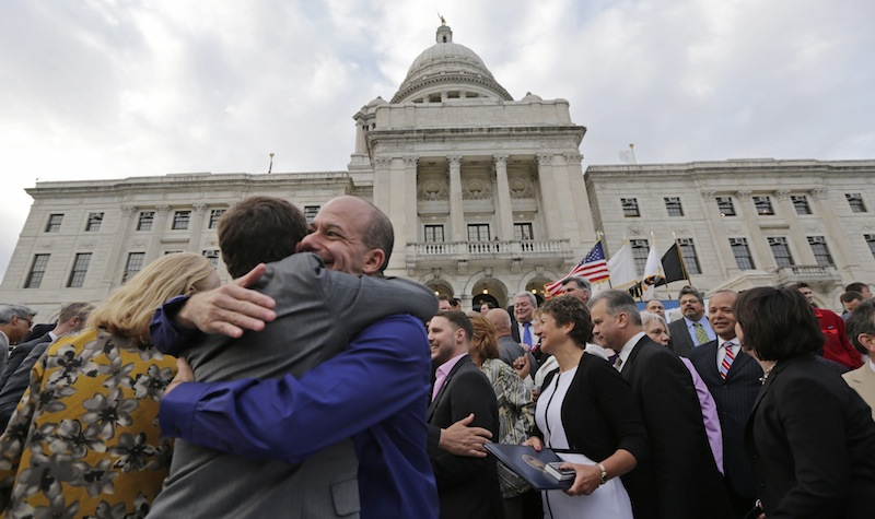 Two men embrace after a gay marriage bill was signed into law outside the State House in Providence, R.I., Thursday, May 2, 2013. (AP Photo/Charles Krupa)