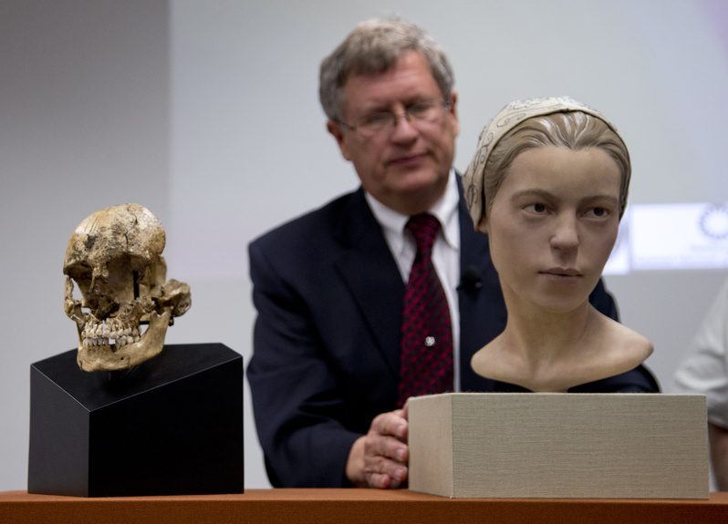 Doug Owsley, who leads the division for Physical Anthropology at the Smithsonian's National Museum of Natural History, displays the skull and facial reconstruction of