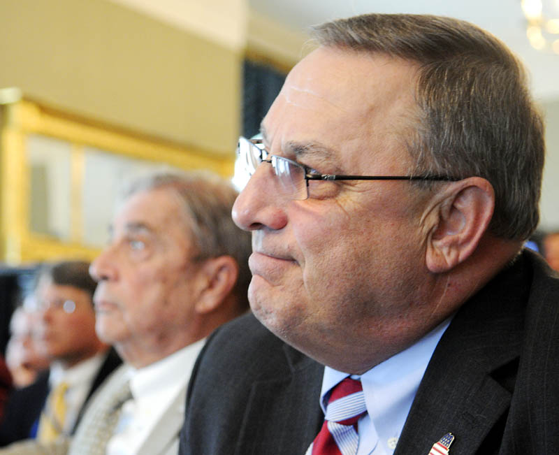 Gov. Paul LePage listens to demographic data Monday at the Blaine House.