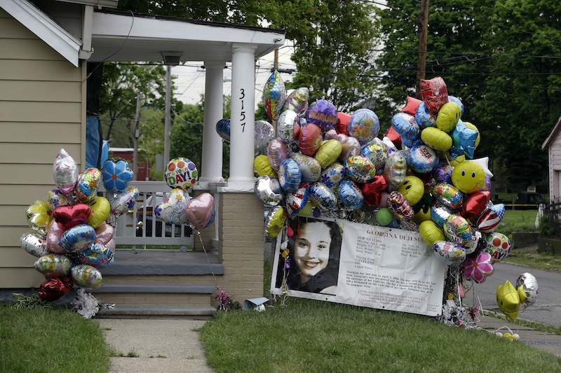Balloons surround the porch at the home of Gina DeJesus in Cleveland Friday, May 10, 2013. DeJesus was freed Monday from the home of Ariel Castro where she and two other women had been held captive for nearly a decade. (AP Photo/Mark Duncan)