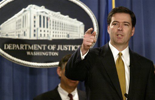 In this Jan. 14, 2004, photo, then-Deputy Attorney General James Comey answers questions during a news conference in Washington.