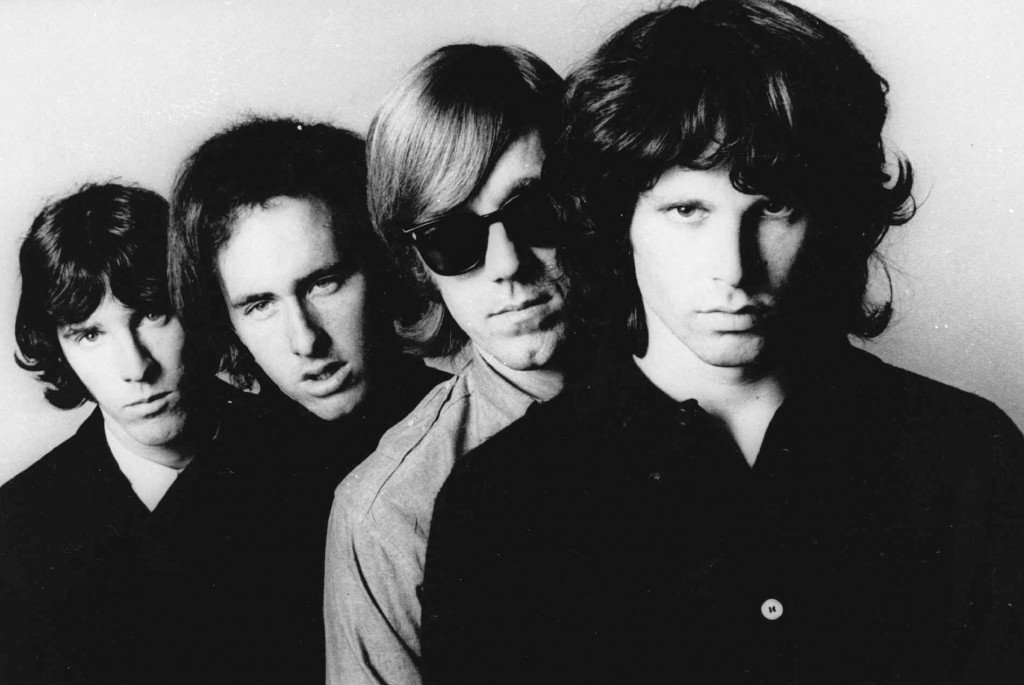 In this undated publicity file photo, members of the Doors, from left, John Densmore, Robbie Krieger, Ray Manzarek and Jim Morrison, pose for a portrait. Manzarek, the keyboardist who was a founding member of The Doors, has died at 74. Publicist Heidi Robinson-Fitzgerald says in a news release that Manzarek died Monday, May 20, 2013, at the RoMed Clinic in Rosenheim, Germany, surrounded by his family. (AP Photo, File)