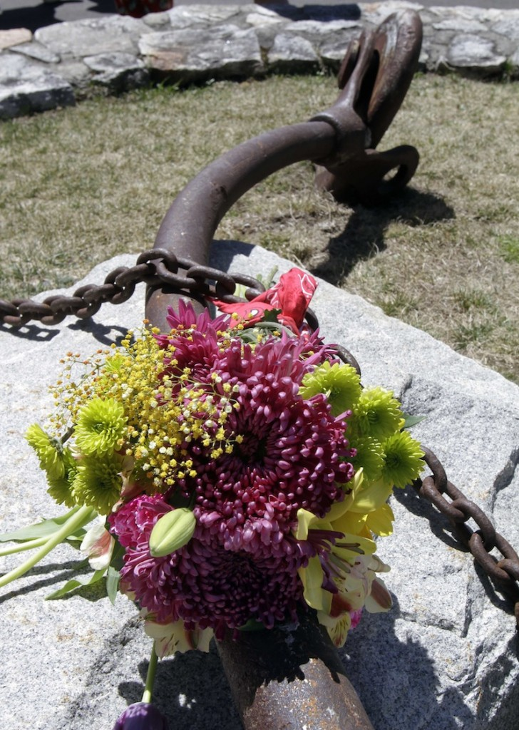 Flowers are seen on one of the turnbuckles that once held the Old Man of the Mountain together Friday, May 3, 2013 in Franconia, N.H. during a ceremony for the 10th anniversary of the date the natural rock formation and state emblem crashed to the ground.(AP Photo/Jim Cole)