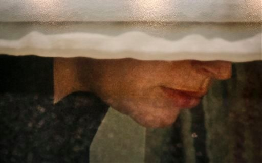 A detail from a photo by Arne Svenson that hangs inside the Julie Saul Gallery in New York. Residents of an apartment building are livid over the exhibition of photos secretly snapped through their apartment windows.