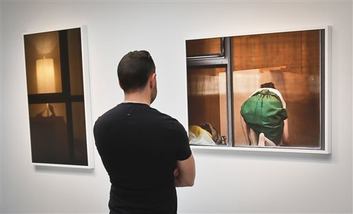 A visitor views the photography of Arne Svenson on Thursday at the Julie Saul Gallery in New York.