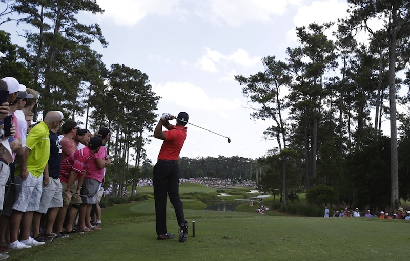 Tiger Woods hits from the fifth tee Sunday during the final round of The Players Championship golf tournament at TPC Sawgrass.