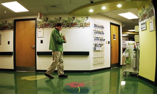 Bob Woodruff, a volunteer cuddler, walks the hallway with a baby at East Tennessee Children's Hospital in Knoxville, Tenn. East Tennessee Children's Hospital