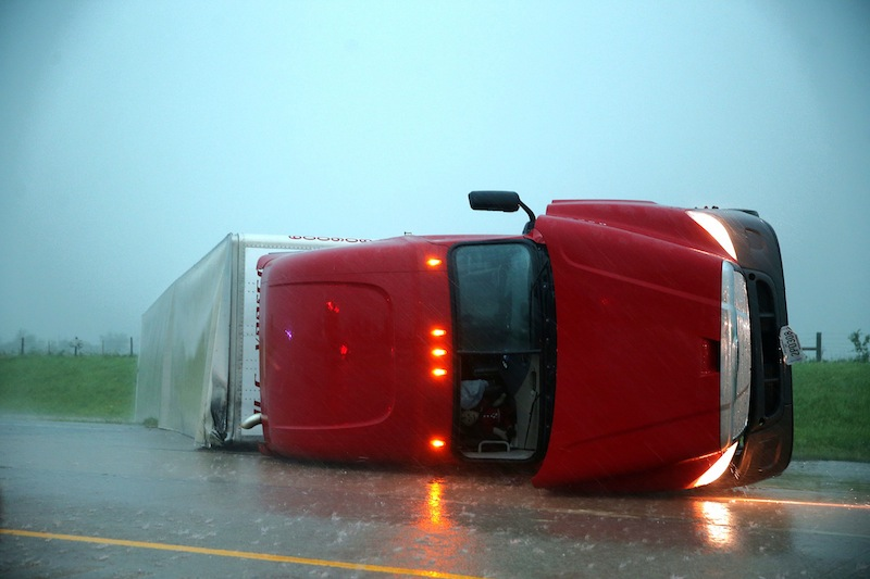 An overturned semitrailer rests on its side on the eastbound lanes of Interstate 40, just east of El Reno, Okla., after a reported tornado touched down, Friday, May 31, 2013. (AP Photo/The Omaha World-Herald, Chris Machian)