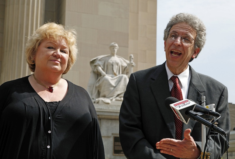 This June 6, 2011 file photo shows Betty Cockrum, left, president of Planned Parenthood of Indiana and attorney Ken Faulk speaking to reporters outside the Federal Courthouse in Indianapolis. Indiana will likely stop defending a law that stripped Medicaid funds from Planned Parenthood after the Supreme Court declined to hear the case Tuesday, May 28, 2013 an attorney who represents the nation's largest abortion provider said. (AP Photo/Michael Conroy, FILE)