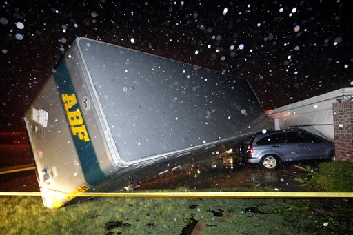 A trucking company trailer landed on a car that was parked in front of a home in Cleburne, Texas, after a powerful storm went through Wednesday night.
