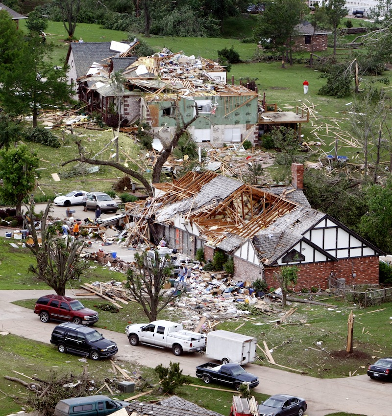 This aerial photo shows damage in the Rolling Meadow Estates neighborhood on Friday, May 31, 2013 in Broken Arrow, Okla. after a tornado passed the area overnight. The storms rolled across the region overnight, and more bad weather was poised to strike Friday, with tornadoes and baseball-sized hail forecast from Oklahoma, Kansas and Missouri. Flooding also is a concern in parts of Missouri, Iowa and Illinois through Sunday. (AP Photo/Tulsa World, Tom Gilbert)