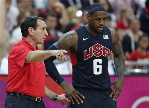 In this Aug. 4, 2012, photo, U.S. coach Mike Krzyzewski talks with LeBron James during a game against Lithuania at the Summer Olympics in London.