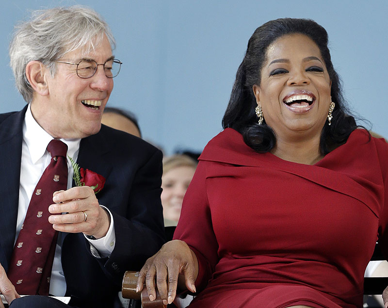 Oprah Winfrey laughs before delivering her address at Harvard University in Cambridge, Mass., Thursday.
