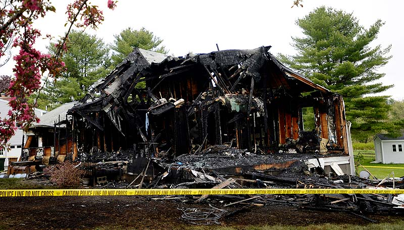 The home at 16 Hillview Ave. that burned following a standoff Saturday night in Saco. Charles Scontras, who was recently separated from his wife, set the fire and and died inside from a self-inflicted gunshot.