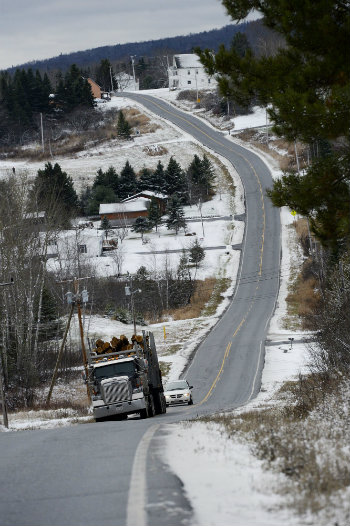 A logging truck heads north on route 11 in St. John Valley just north of Eagle Lake Friday, November 9, 2012. (Press Herald file photo)