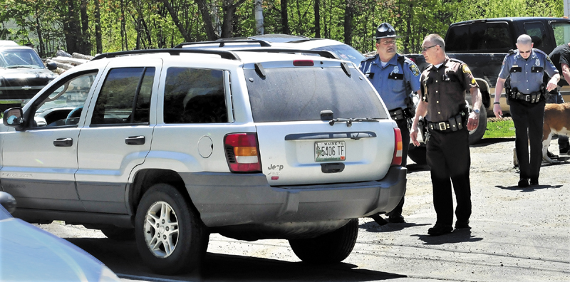 Police from several agencies converged at a residence on Middle Road in Skowhegan after Ernest Almeida of Fairfield abandoned his vehicle, foreground following a police chase where speeds exceeded 100-miles per hour on Wednesday. Police with dogs searched for him after he fled into the woods but did not apprehend him.